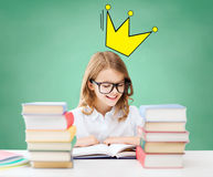 Student girl reading books at school Royalty Free Stock Photos