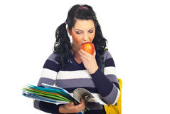 Student girl reading and eating apple Stock Photo