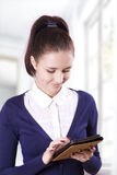 Student girl reading electronic books on an e-reader Royalty Free Stock Photography