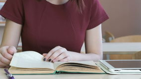 Student girl reads school textbook. Close-up stock footage
