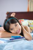 Student girl relaxing at home with books Royalty Free Stock Images