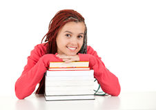 Student girl resting on stack of books Royalty Free Stock Photo