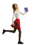 Student girl running with notebooks isolated on white background Stock Photos
