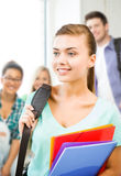 Student girl with school bag and color folders Royalty Free Stock Image