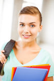 Student girl with school bag and color folders Stock Photos