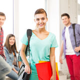 Student girl with school bag and color folders Royalty Free Stock Photo