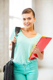 Student girl with school bag and color folders Royalty Free Stock Photography