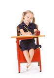 Student: Girl In School Uniform Doing Homework At Desk Royalty Free Stock Photos