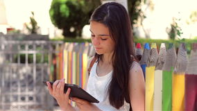 Student girl shows tablet pc at camera stock video footage