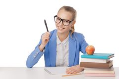 Student  girl sit at the table, holding pen Royalty Free Stock Photo