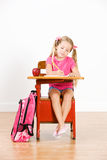 Student: Girl Sits At School Desk Writing In Notebook Stock Photo