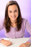Student girl sitting behind desk purple portrait Royalty Free Stock Photography