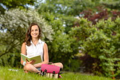 Student girl sitting grass with open book Stock Photography