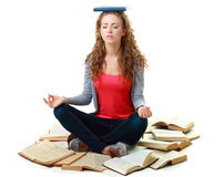 Student girl sitting and meditating with books Stock Photos
