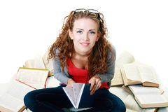 Student girl sitting and meditating with books Royalty Free Stock Photo