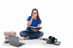 Student girl sitting studding and yawning Royalty Free Stock Photos