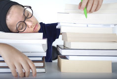 Student girl is sleepingon the boks Royalty Free Stock Photo