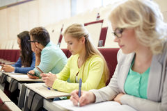 Student girl with smartphone at lecture Royalty Free Stock Images