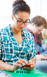 Student girl with smartphone at school Stock Image