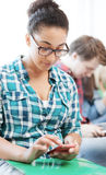 Student girl with smartphone at school Royalty Free Stock Photo