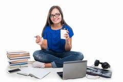 Student girl having coffee around books and telephone Stock Photos