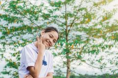 Student girl with nature contryside nature. Student girl smiling with nature contryside nature in evening light Royalty Free Stock Photos