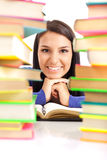 Student girl between stack of books Stock Image