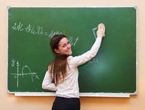 Student girl standing near blackboard Royalty Free Stock Photos