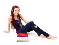 Student girl with stock of books Royalty Free Stock Images