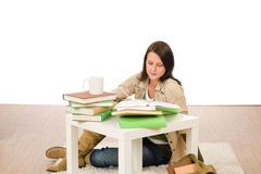 Student girl studying home sitting on floor Royalty Free Stock Photos