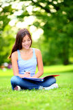 Student girl studying in park Royalty Free Stock Photography