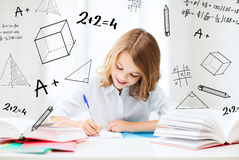 Student girl studying at school Royalty Free Stock Image