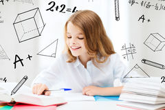 Student girl studying at school Stock Photos