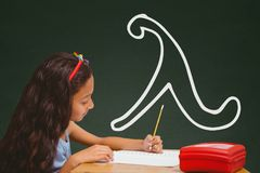 Student girl at table writing against green blackboard with school and education graphic Stock Photos