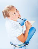 Student girl thinking on exam Stock Photo