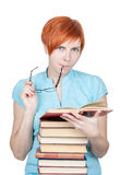 Student girl thinks about read in the book Royalty Free Stock Images