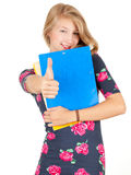 Student girl with thumb up and books Stock Image