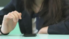 Student girl typing text in smartphone. Close-up stock footage