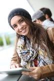 Student girl using tablet websurfing Stock Image