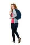 Student girl walking away Royalty Free Stock Photos