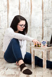 Student girl is wearing pair of glasses is studying on laptop wh Stock Photo