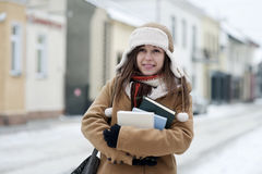 Student girl in wintertime. Winter collection: portrait of beautiful student girl in wintertime Royalty Free Stock Photos