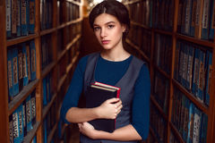 Student girl or woman with books in library. Royalty Free Stock Photos