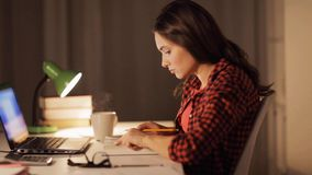 Student girl or woman reading book at night home stock footage