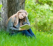 Student girl working in park Stock Photo
