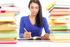 Student girl writing. Concentrate student girl writing, isolated on white background Stock Images