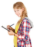 Student girl writing on clipboard Royalty Free Stock Photo