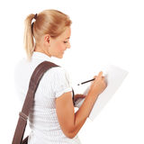 Student girl writing exams Royalty Free Stock Photography