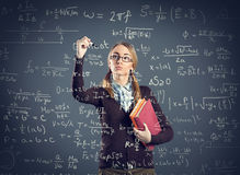 Student girl writing formulas on transparent wall Royalty Free Stock Photography