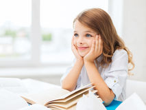 Student girl writing in notebook at school Royalty Free Stock Photography